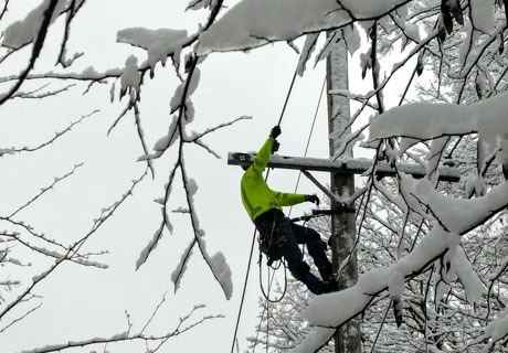 Lineman on pool during winter storm